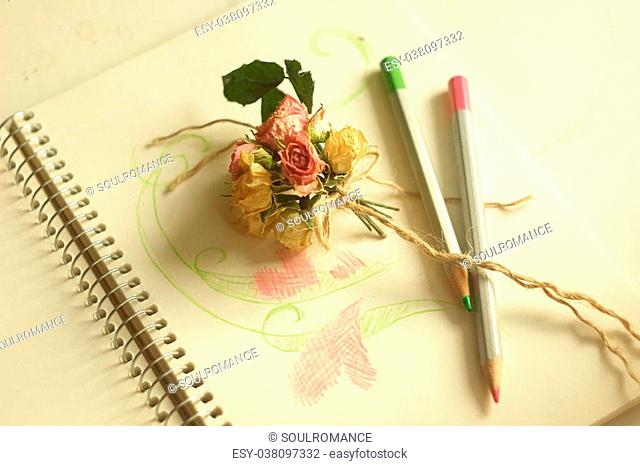 A little creativity in gentle colors of roses and pencils