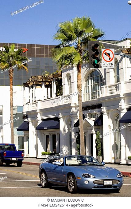 United States, California, Los Angeles, Beverly Hills, luxury car at the intersection of Little Santa Monica Blvd and Rodeo Drive