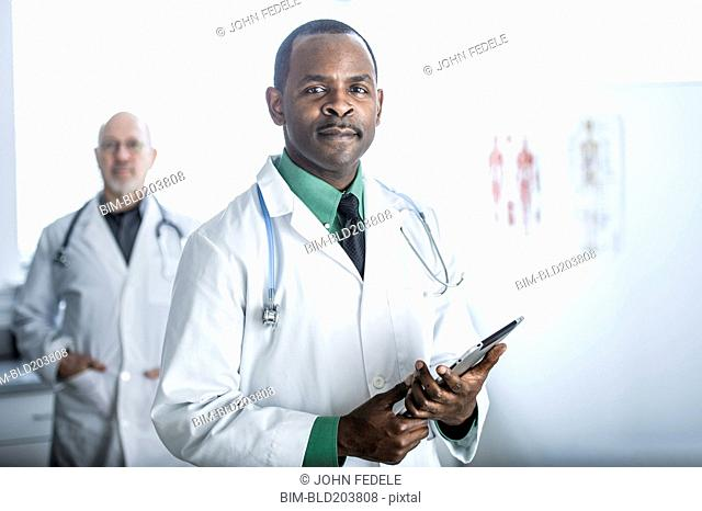 African American doctor standing in office