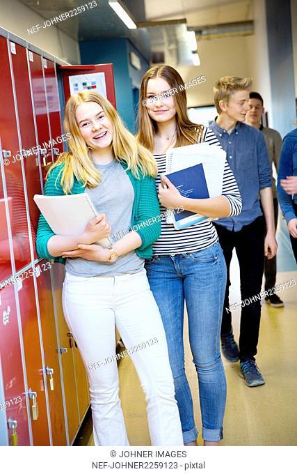 Teenage girls standing in corridor