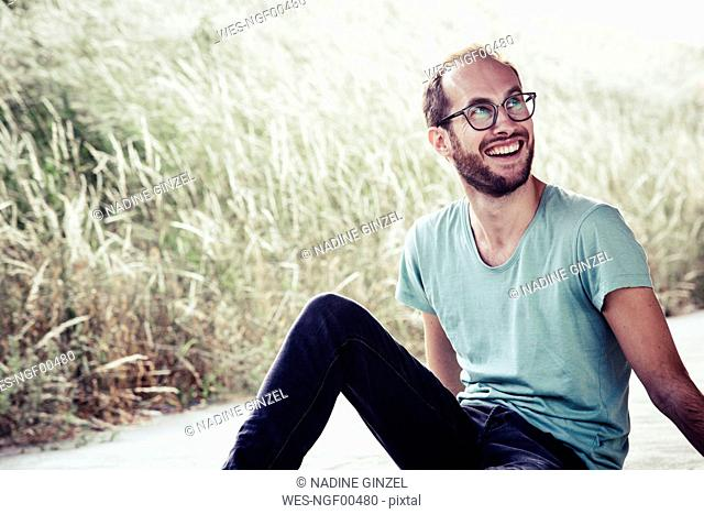 Portrait of laughing man outdoors