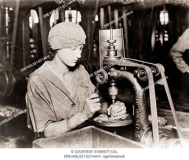 Woman countersinking a detonator tube hole in hand grenade at Westinghouse Electric & Manufacturing. Company, during World War I