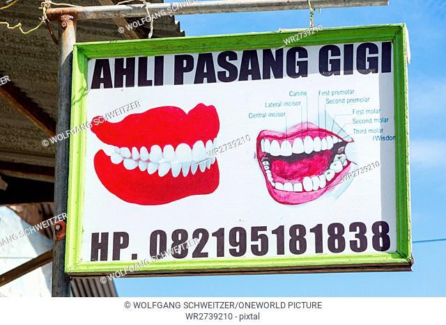 Indonesia, Maluku Utara, Kabupaten Halmahera Utara, sign of a dental practice in the village of Tobelo on northern Molikken