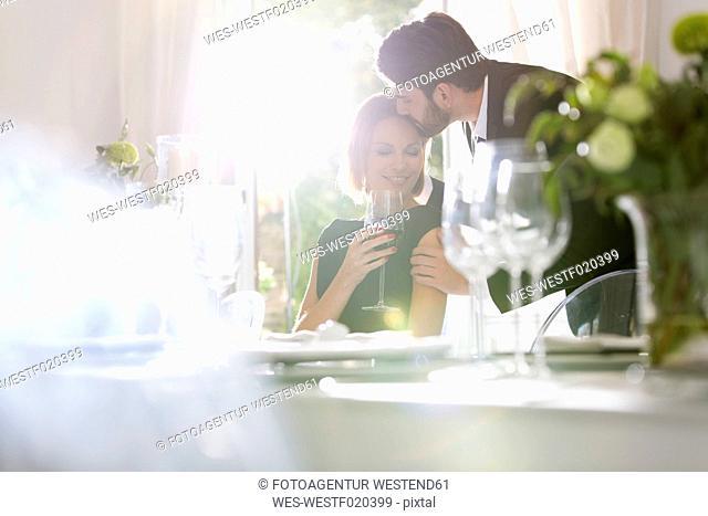 Elegant couple in restaurant