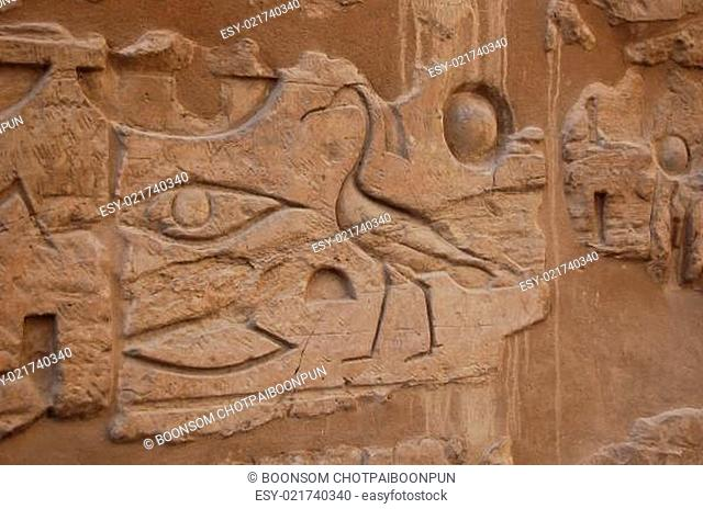 Hieroglyphics relief on wall in Luxor temple, Egypt