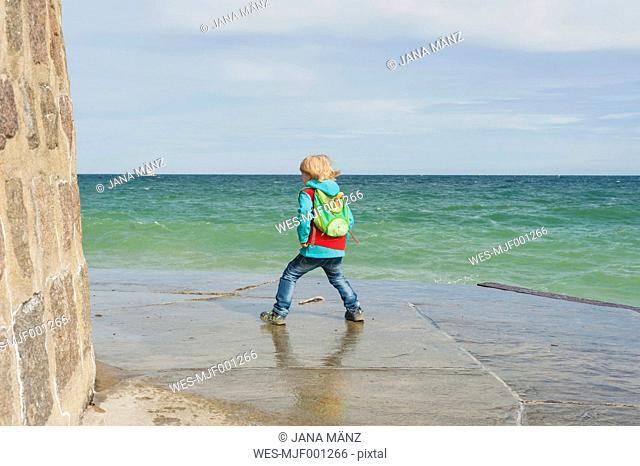 Germany, Mecklenburg-Western Pomerania, Ruegen, Sassnitz, Boy on pier