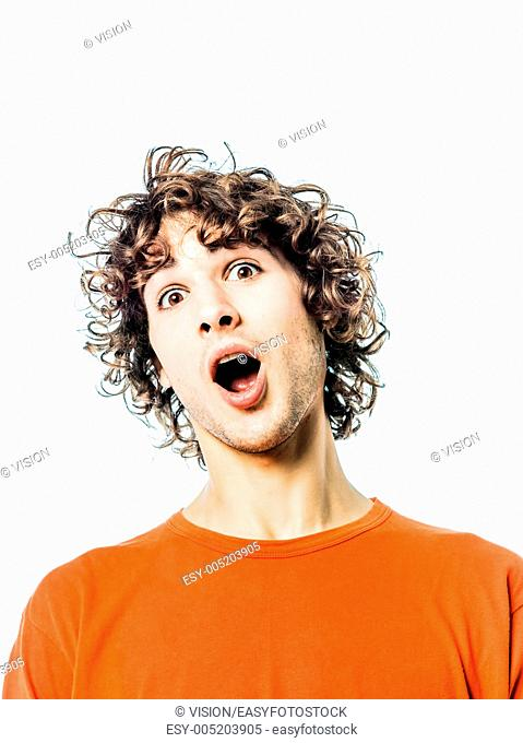 one young man caucasian surprised amazed portrait in studio white background