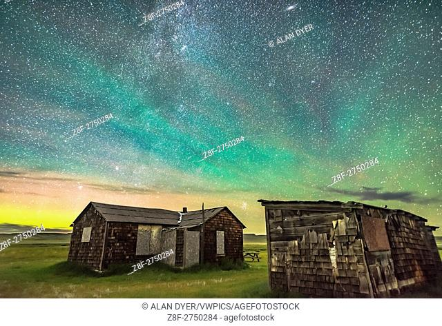 The Pleiades rising behind the rustic cabins and outbuildings of the historic Larson Ranch in Grasslands National Park, Saskatchewan