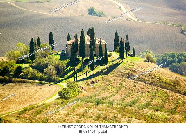 Villa with cypresses in Tuscany, Italy