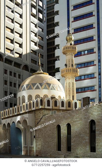 Mosque and modern building downtown Abu Dhabi, UAE