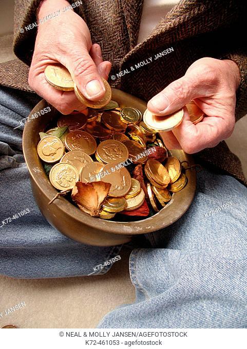 Man Holding Pot of Gold
