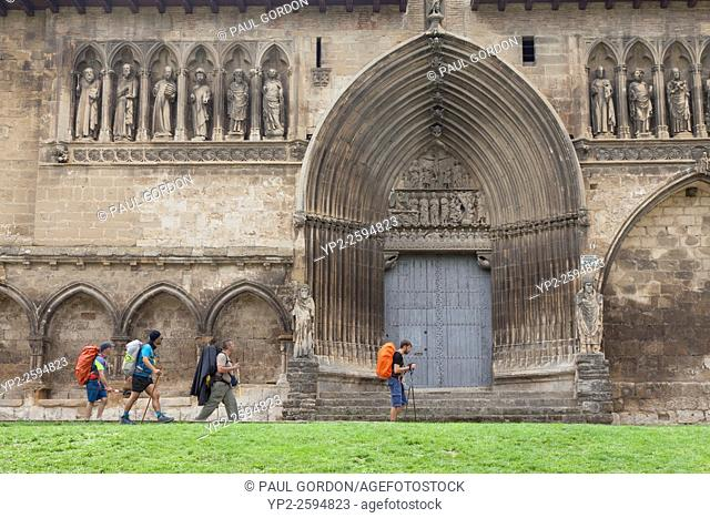 Pilgrims passing the Church of Holy Sepulchre as they enter the village of Estella-Lizarra - Navarre, Spain