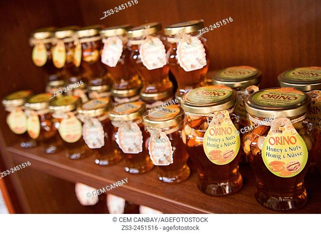 Bottles of honey at the market stall, Chania Region, Crete, Greek Islands, Greece, Europe