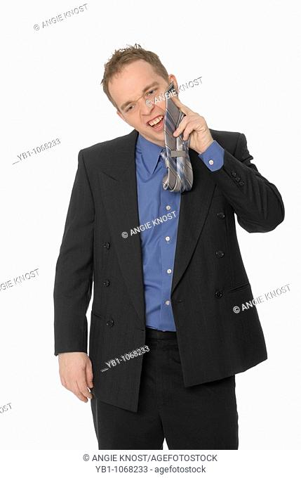 Business man wiping his face with his tie, nervous or bad manners