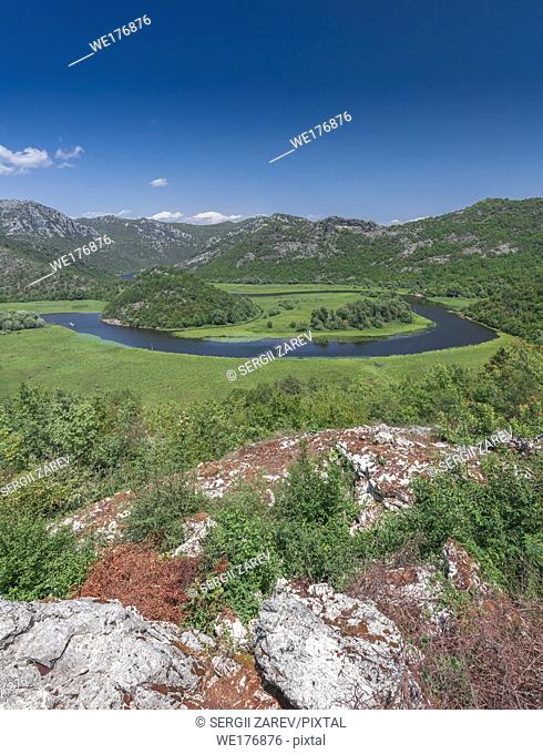 Panoramic view from above of Skadar lake and Crnojevica river in a national park, Montenegro, in a sunny summer day