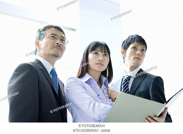 Business Scene, Three People Looking Away