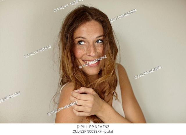 Smiling woman sitting indoors