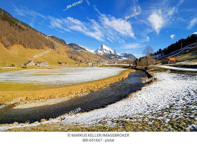 The Thur river and the snow-covered Wildhauser Schafberg mountain - Alt St. Johann, Canton of St. Gallen, Switzerland, Europe