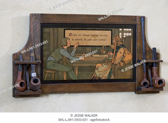 ANTIQUES, Arts and Crafts pipe rack, wall style with print in the middle ' Riches are always restless, tis only to poverty the gods give content' is the verse