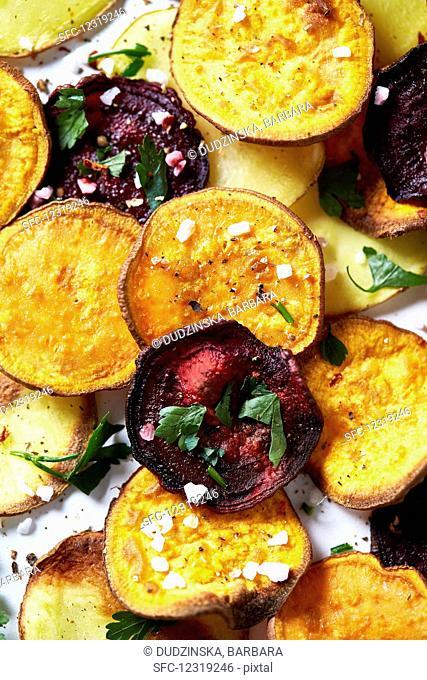 Potato, sweet potato and beetroot crisps with sea salt and herbs