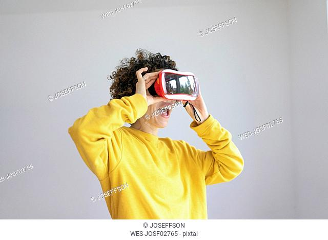 Excited woman wearing VR glasses