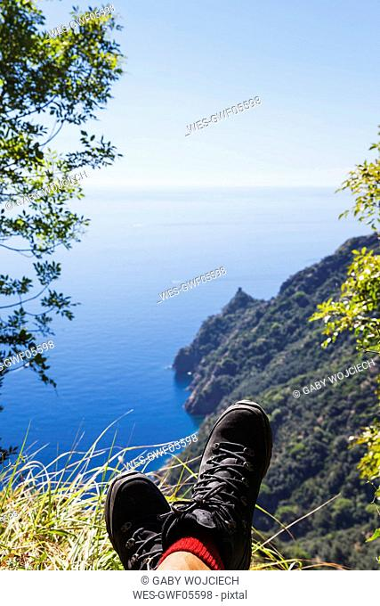 Italy, Liguria, Portofino Peninsula, Hiker resting in the mountains