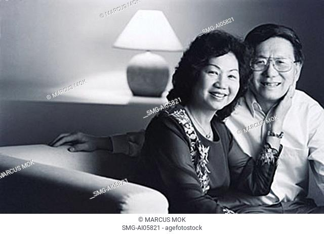 Man and woman in living room, portrait