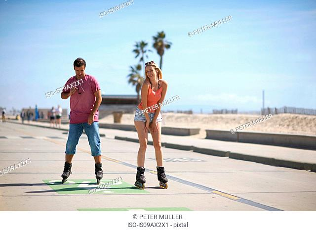 Couple rollerblading outdoors