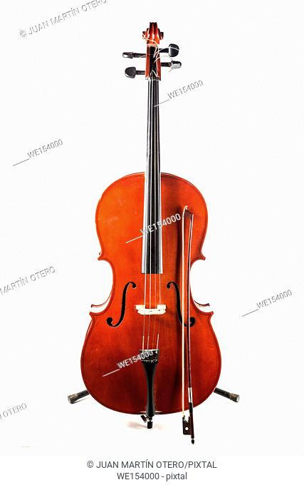 Old cello with his bow isolated on white background