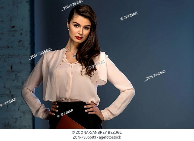 Portrait glamorous brown-haired business style girl
