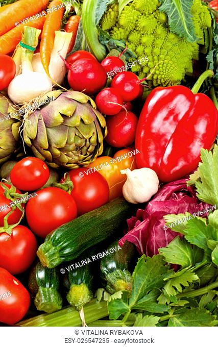 Background of mixed fresh organic vegetables and herbs