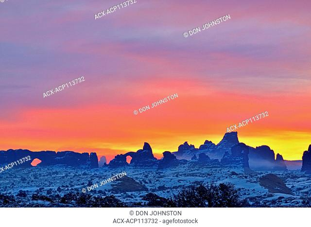 Sunrise skies near the North Window, Turret Arch and the La Sal Mountains, Arches National Park, Utah, USA