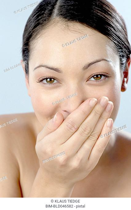 Mixed Race woman laughing