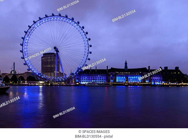 London Eye and waterfront lit up at night, London, United Kingdom
