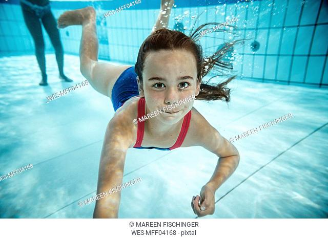 Portrait of girl under water in swimming pool
