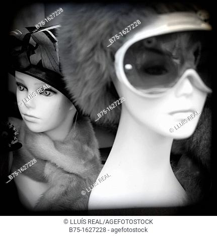 photograph of two busts of women mannequins, one with sunglasses