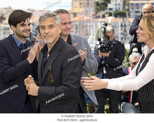 Actors George Clooney and Julia Roberts attend the photocall of Money Monster during the 69th Annual Cannes Film Festival at Palais des Festivals in Cannes