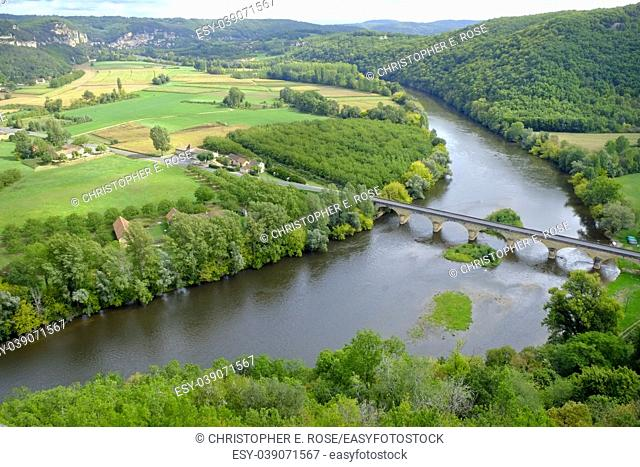 Late summer view over patchwork fields and river of the Dordogne valley near Castelnaud-la-Chapelle, Aquitane, France