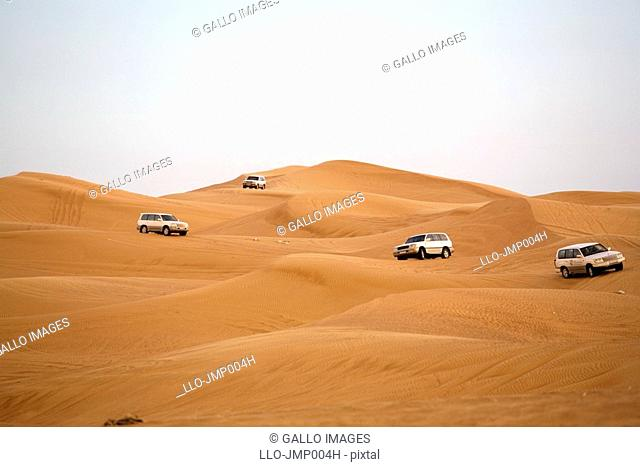Off-road Vehicles Navigating Down a Sand Dune  Hatta, United Arab Emirates
