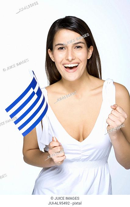 Young woman holding Greek flag