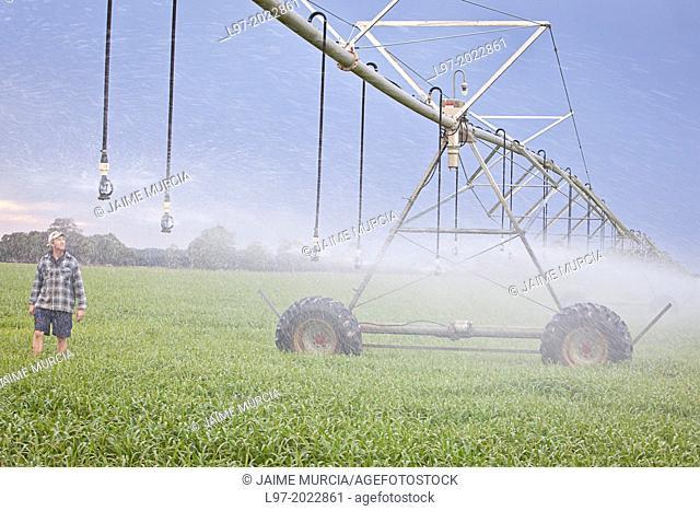 A farmer inspects his center pivot irrigation system, Victoria Australia