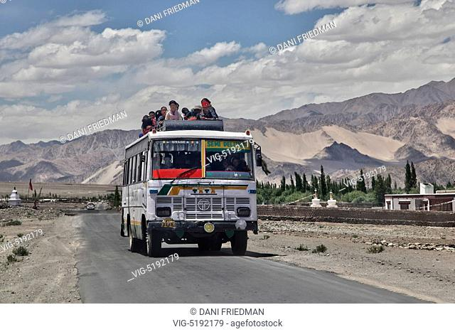 Ladakhi Buddhist pilgrims travel on top an overloaded bus in the city of Leh to listen to His Holiness the 14th Dalai Lama perform prayers during the 33rd...