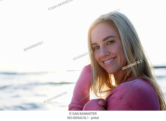 Woman looking sideways at camera