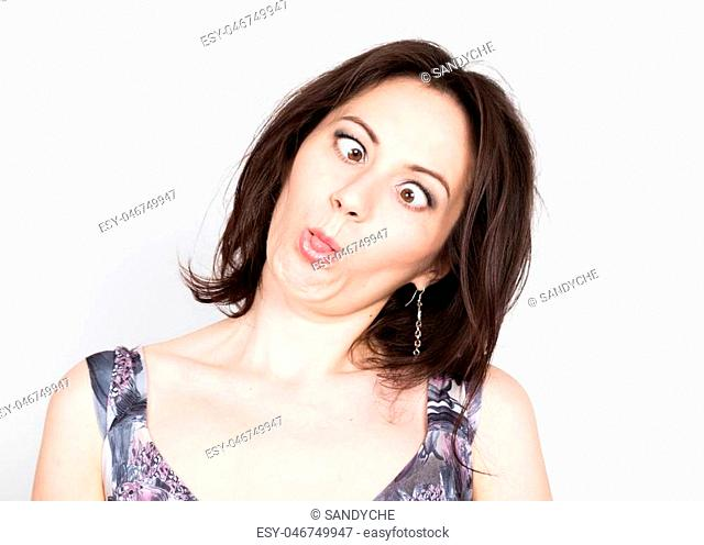 beautiful young brunette woman in a colorful dress posing and expresses different emotions. girl's hands shows various signs, close-up portret