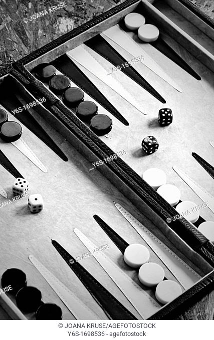 Backgammon game with playing pieces and dice