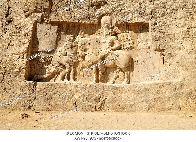 sassanid relief of the triumph of king Shapur I  over the Roman Emperor Valerian and Philip the Arab at the achaemenid burial site Naqsh-e Rostam