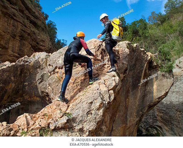 Man and woman doing canyoning