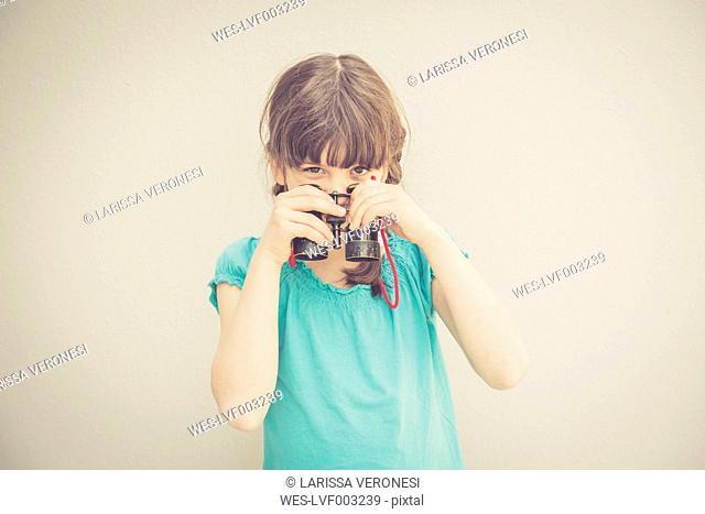 Girl with binocular