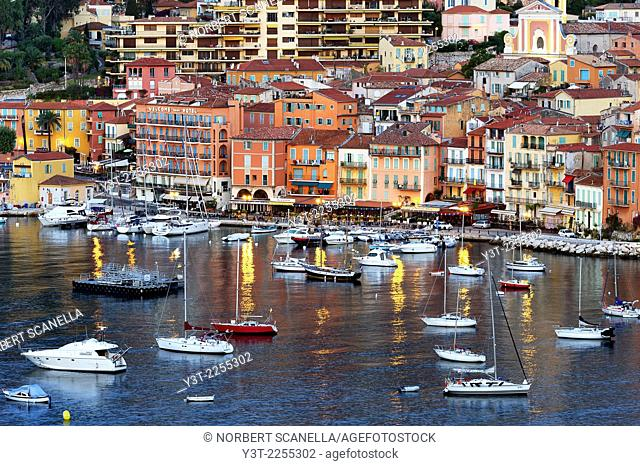 Europe, France, Alpes-Maritimes, Villefrance-sur-Mer. The bay and the colored houses of old town at early morning