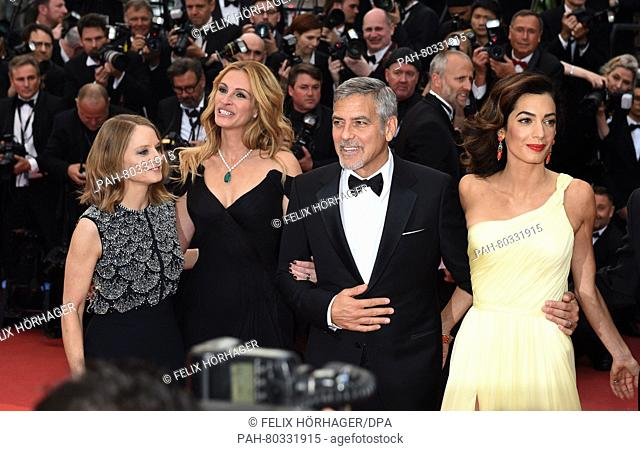 US director Jodie Foster, (l-r) US actress Julia Roberts, US actor George Clooney and his wife Amal arrive for the screening of 'Money Monster' during the 69th...